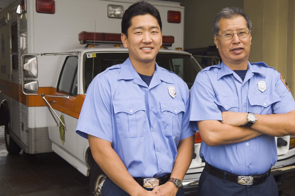 Stock Photo: 1589R-46005 Asian male paramedics in front of ambulance