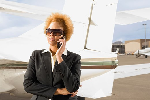 Stock Photo: 1589R-46100 African American businesswoman talking on cell phone