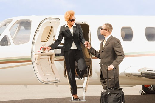 African American businesswoman getting off airplane : Stock Photo