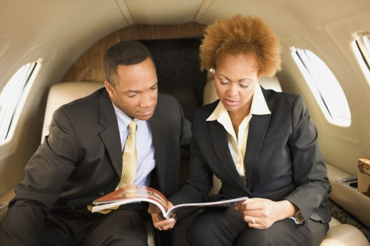 Stock Photo: 1589R-46121 African American businesspeople on airplane