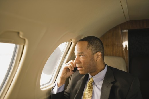African American businessman on airplane : Stock Photo