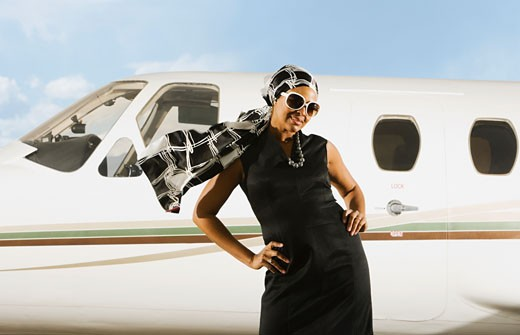 Stock Photo: 1589R-46141 African American woman in front of airplane