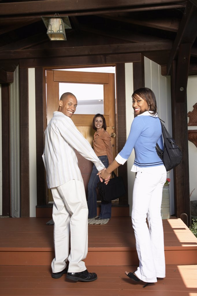 Stock Photo: 1589R-46178 African American couple entering house