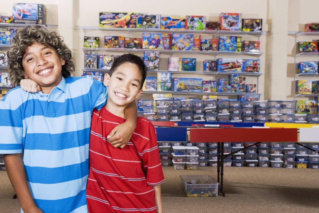 Stock Photo: 1589R-46257 Multi-ethnic boys hugging