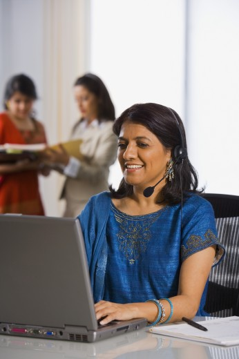 Stock Photo: 1589R-46332 Indian businesswoman wearing headset