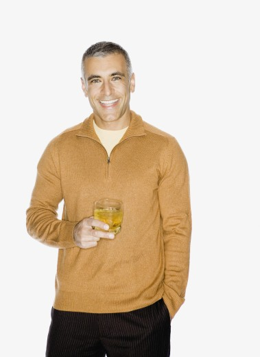 Stock Photo: 1589R-46445 Middle Eastern man holding drink