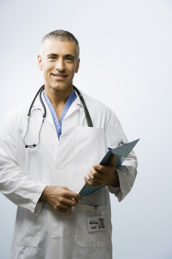Stock Photo: 1589R-46456 Middle Eastern male doctor holding chart