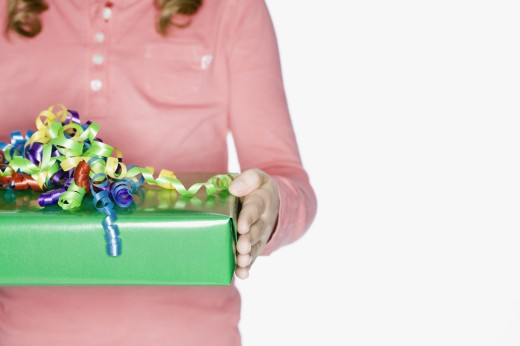 Stock Photo: 1589R-46496 Hispanic girl holding gift