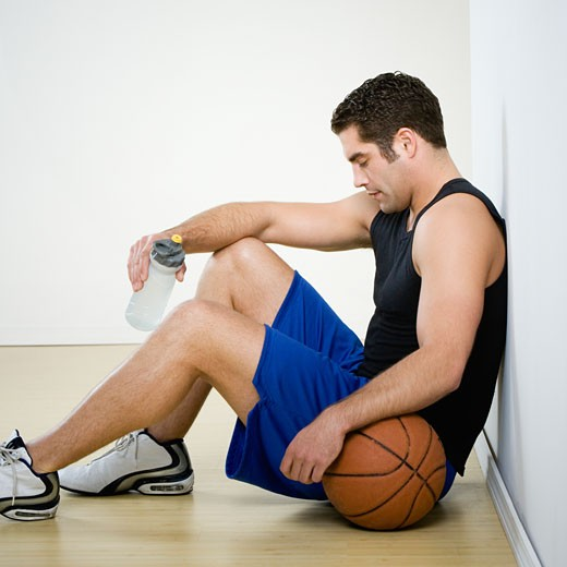 Stock Photo: 1589R-46517 Hispanic man in athletic gear with basketball