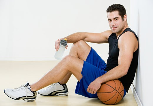 Hispanic man in athletic gear with basketball : Stock Photo
