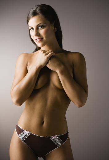 Semi-nude woman covering breasts : Stock Photo