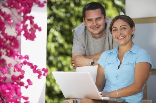 Stock Photo: 1589R-47004 Multi-ethnic couple with laptop