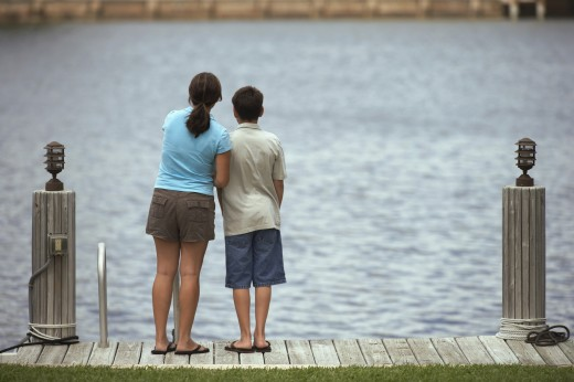 Mixed Race brother and sister on dock : Stock Photo
