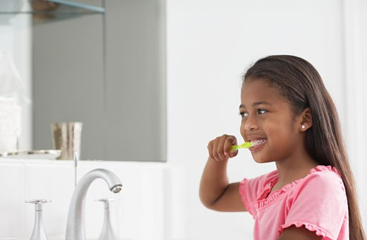 Stock Photo: 1589R-47062 Mixed Race girl brushing teeth