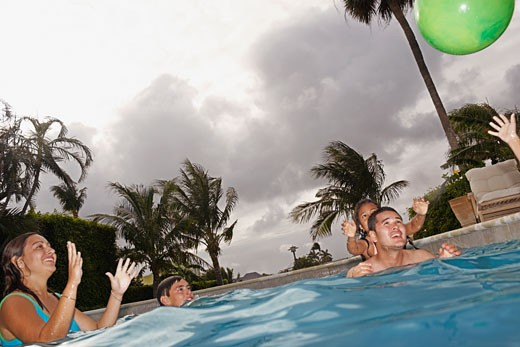 Stock Photo: 1589R-47081 Multi-ethnic family in swimming pool