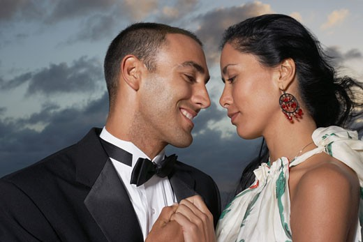 Hispanic couple smiling at each other : Stock Photo