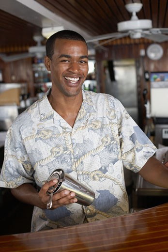 Stock Photo: 1589R-47219 African American male bartender holding shaker