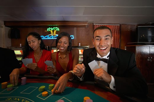Multi-ethnic couples gambling : Stock Photo