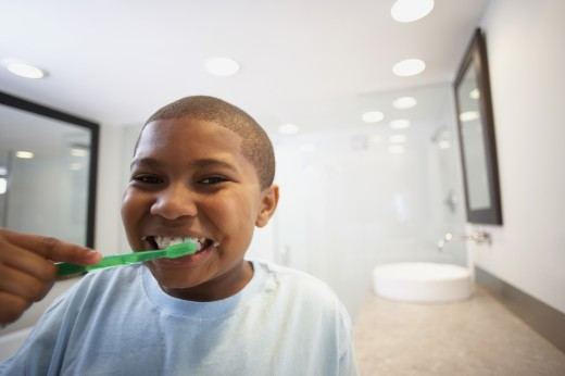 African American boy brushing teeth : Stock Photo