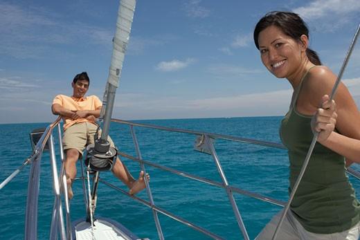 Stock Photo: 1589R-47539 Multi-ethnic couple on sailboat