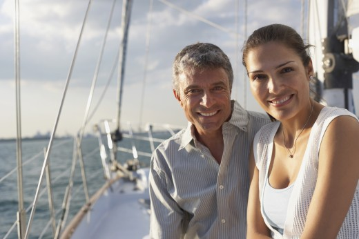 Stock Photo: 1589R-47600 Multi-ethnic couple sitting on sailboat