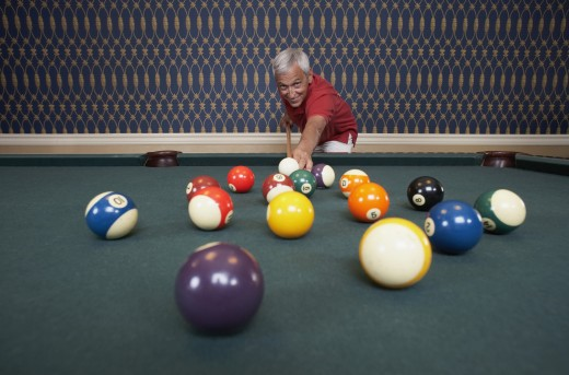 Stock Photo: 1589R-47695 Senior man playing pool