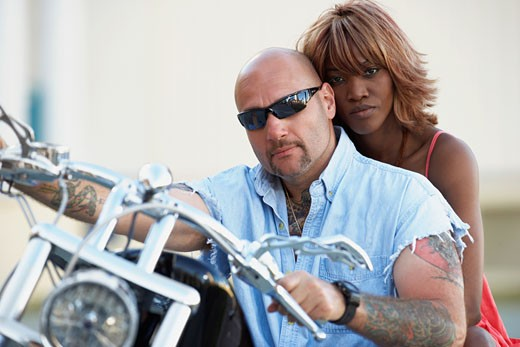 Stock Photo: 1589R-47766 Multi-ethnic couple on motorcycle