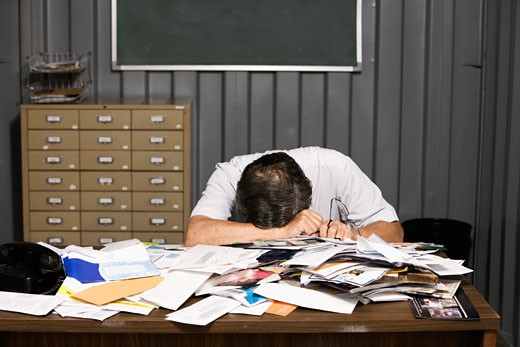 Stock Photo: 1589R-47839 Senior Asian businessman resting head on cluttered desk
