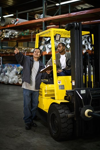 Multi-ethnic workers in carpet warehouse : Stock Photo