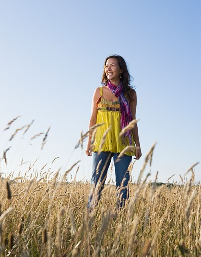 Stock Photo: 1589R-48485 Hispanic woman standing in field