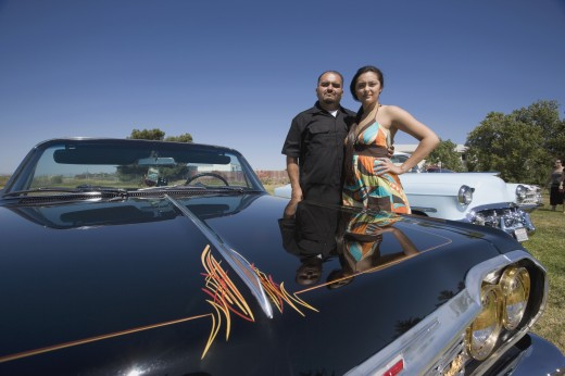 Stock Photo: 1589R-48538 Hispanic couple next to show car