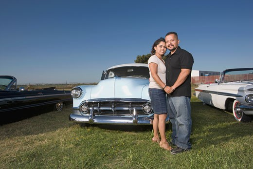 Stock Photo: 1589R-48554 Hispanic couple in front of low rider cars