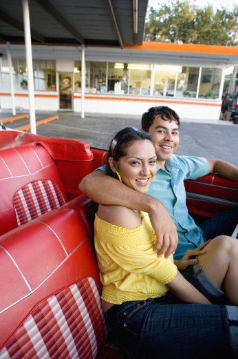 Stock Photo: 1589R-48586 Hispanic couple sitting in convertible