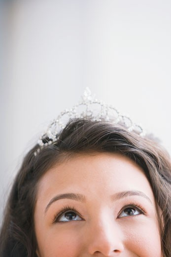 Stock Photo: 1589R-48647 Hispanic teenaged girl wearing tiara