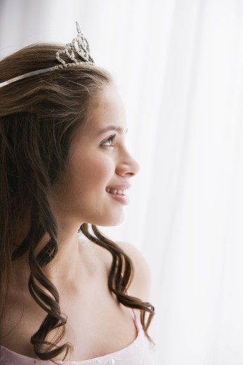 Stock Photo: 1589R-48657 Hispanic teenaged girl wearing tiara