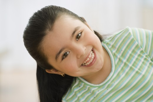 Close up of Hispanic girl smiling : Stock Photo