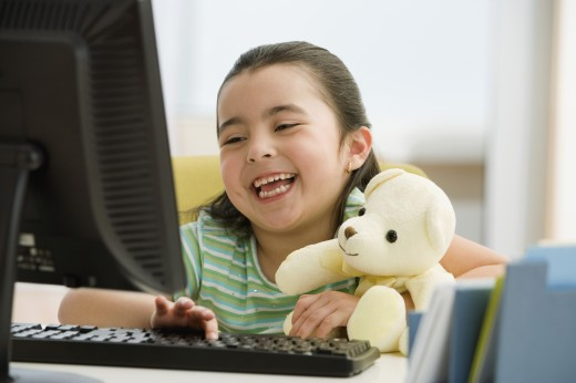 Hispanic girl typing on computer : Stock Photo