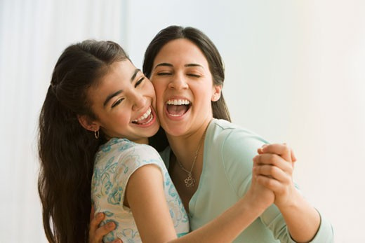 Stock Photo: 1589R-48803 Hispanic mother and daughter dancing
