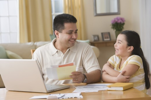 Hispanic father and daughter smiling at each other : Stock Photo