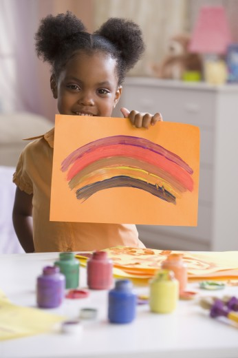 Stock Photo: 1589R-48951 African American girl holding up painting