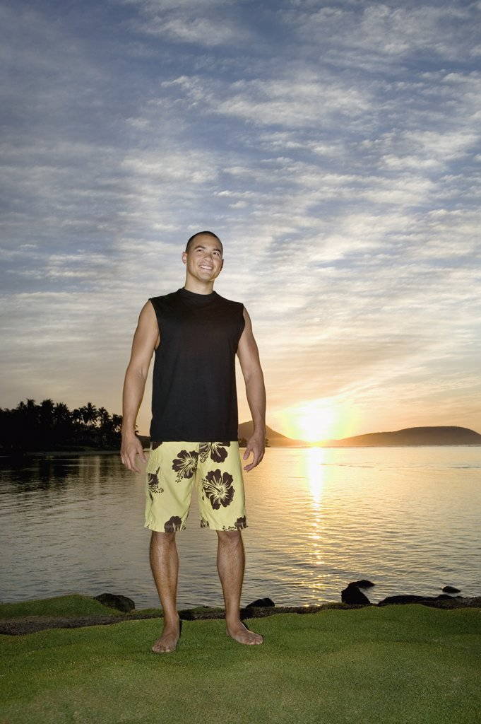 Stock Photo: 1589R-49057 Asian man next to water at sunset