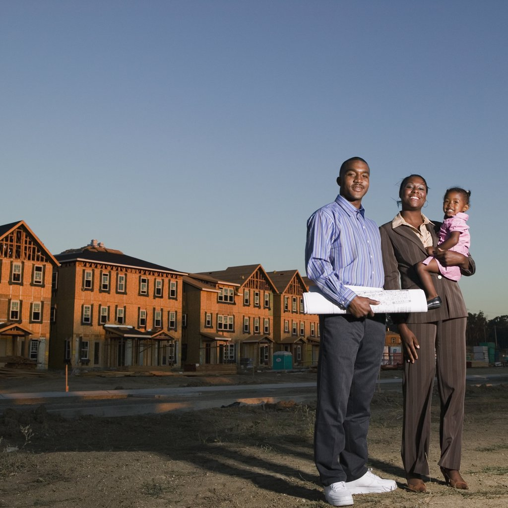 African American family at residential construction site : Stock Photo