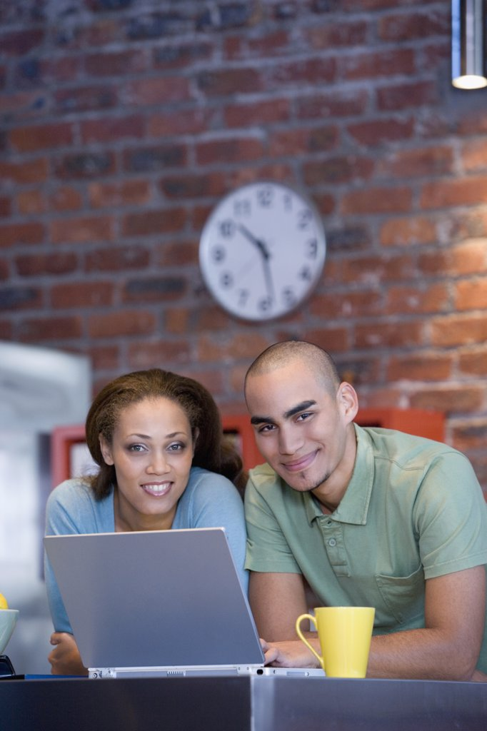 Stock Photo: 1589R-49145 African American couple with laptop