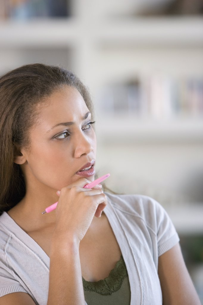 Stock Photo: 1589R-49173 African American woman thinking