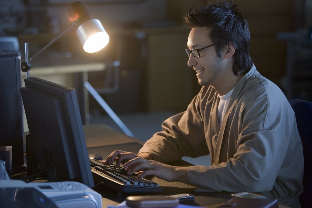 Stock Photo: 1589R-49257 Asian businessman typing on computer
