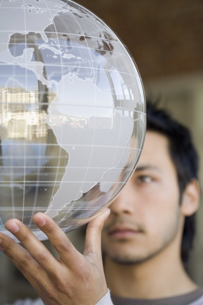 Asian man holding globe : Stock Photo