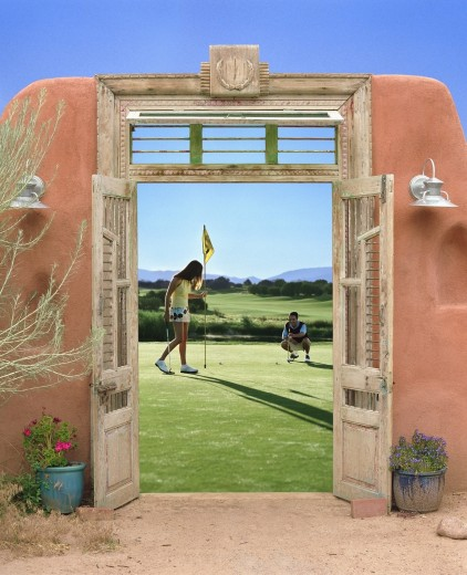 Stock Photo: 1589R-49686 View through doorway to couple playing golf
