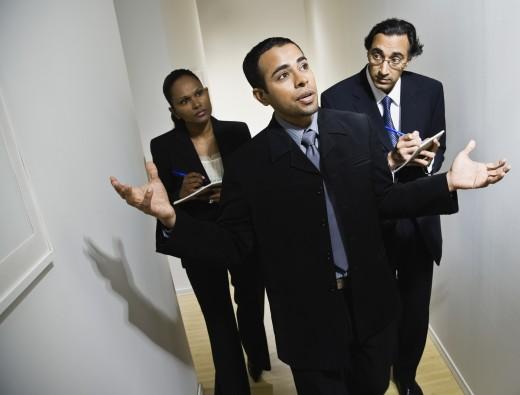 Stock Photo: 1589R-50027 Multi-ethnic businesspeople walking in hallway