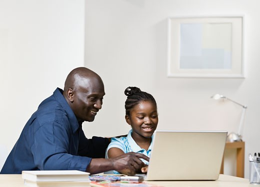 Stock Photo: 1589R-50050 African father and daughter looking at laptop