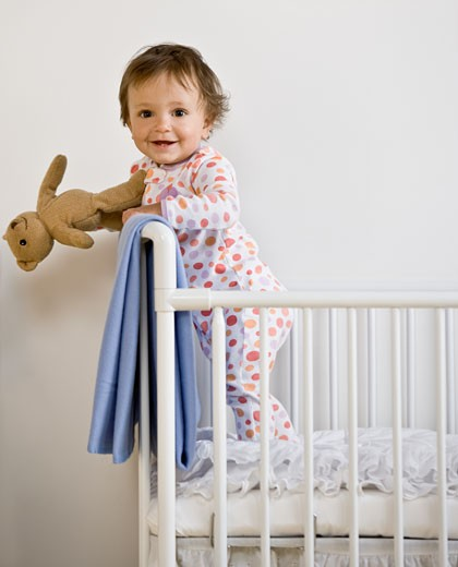 Stock Photo: 1589R-50168 Hispanic baby in crib